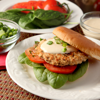 Turkey burgers don't have to be boring! These are loaded with flavors like orange juice and soy and are spread with a low calorie Greek yogurt aioli.