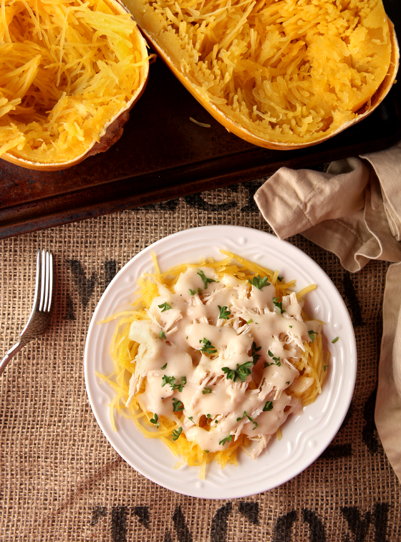 Low calorie spaghetti squash chicken alfredo - a great alternative to higher calorie alfredo pasta, and how to cook perfect al dente spaghetti squash that is not watery!