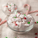 White chocolate coated rice chex cereal mixed with mini M&M's, crushed peppermint and dusted with powdered sugar. An easy Christmas snack mix!