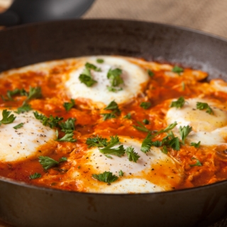 Quick and easy dinner idea - eggs in purgatory using spicy spaghetti sauce - ready in just 10 minutes!