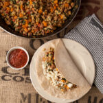 These lower carb healthy burritos can be made for breakfast or dinner! A sizzling skillet of turkey sausage, eggs, sweet potatoes, sweet pepper, spinach, and onion served on a low carb tortilla. Easy breakfast for dinner idea!
