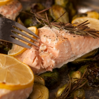 Delicious lemon herb roasted salmon with fresh rosemary and lemon slices