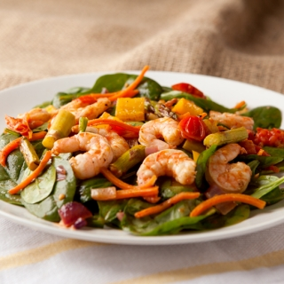 Roasted seasoned vegetables and shrimp tossed with baby spinach and a homemade chili vinaigrette dressing. Delicious low carb salad idea!