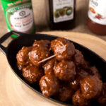 Easy shortcut Asian style garlic sesame turkey meatballs that are out of this world! The sauce is just the right mix of tangy and peanut buttery. Double or triple the recipe to feed a crowd!