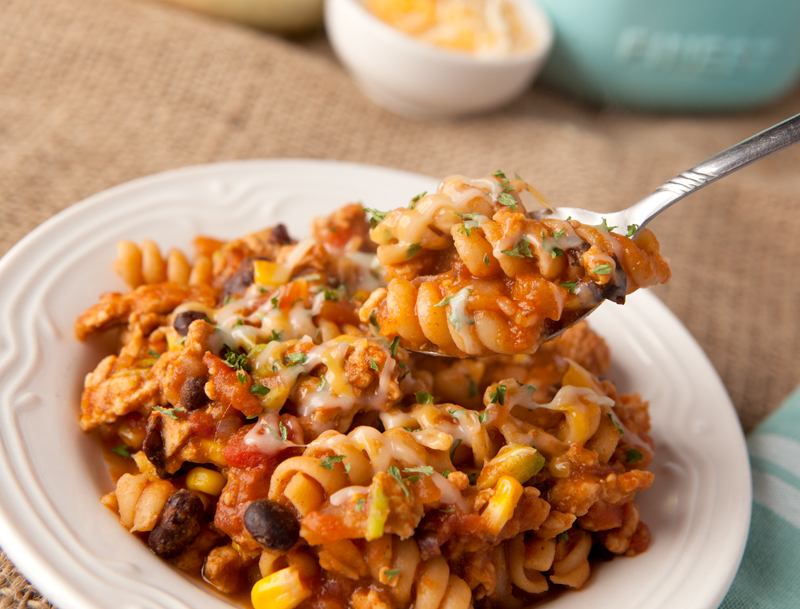 This easy one pot ground turkey taco pasta is full of flavors from tomato sauce, black beans, corn, and even avocado! Lots of complex carb goodness going on from the whole wheat pasta.