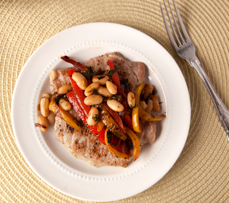 These pork cutlets with sauteed bell peppers and white beans and an easy dinner idea! Low carb and incredibly simple.