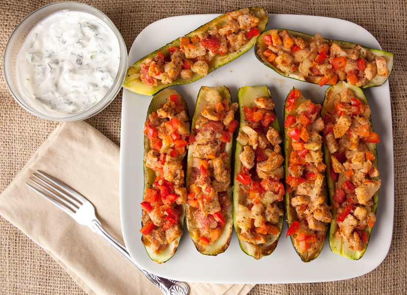 Easy and Fast Low Carb Dinner Idea! Chicken Stuffed Zucchini boats with a a fresh lemon mint topping. I could eat the whole recipe myself