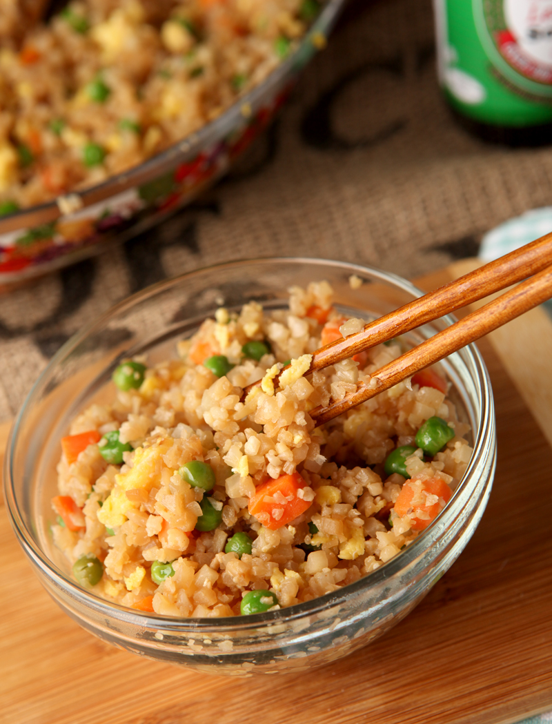 Do you miss yummy Chinese take-out on a low carb diet?  This fried cauliflower rice NEEDS to be in your life!  I promise you it can pass for the real thing - use this cauliflower chinese fried rice on its own, add chicken, or serve with any of your favorite low carb chinese dishes!  Seriously it's so good, you HAVE to try it!