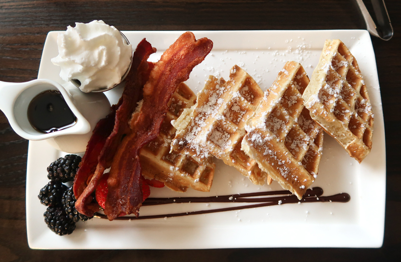 Waffles with bacon and whipped cream at Aviles Restaurant in St. Augustine