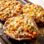 Baked sweet potato stuffed with a Shepherd's Pie filling - cheesy, easy dinner idea that's a riff on a classic favorite.