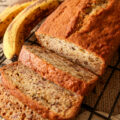 A sliced loaf of delicious banana nut bread