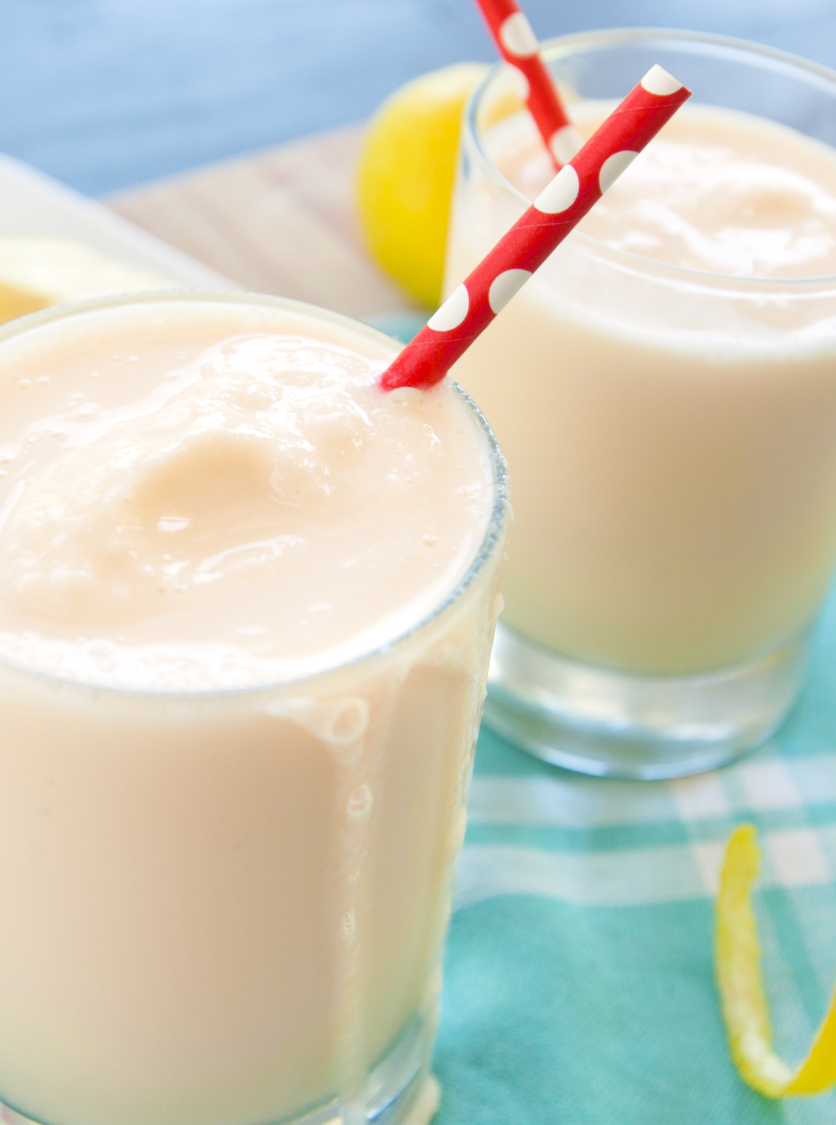 Close up of frosted lemonade with a drizzle leaking down the side of the glass