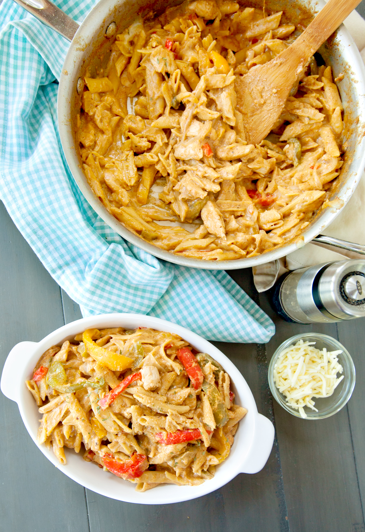 overhead of chicken fajita pasta in pan and in a serving dish