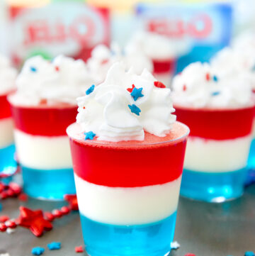 patriotic jello shots with whipped cream and sprinkles