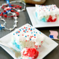 a piece of red white and blue poke cake with bite taken out