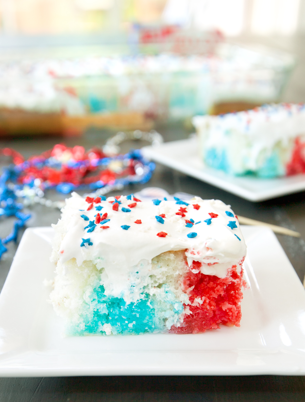 a single slice of red white and blue poke cake