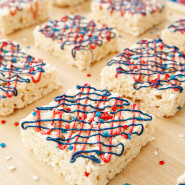 squares of rice krispie treats drizzled with red white and blue frosting