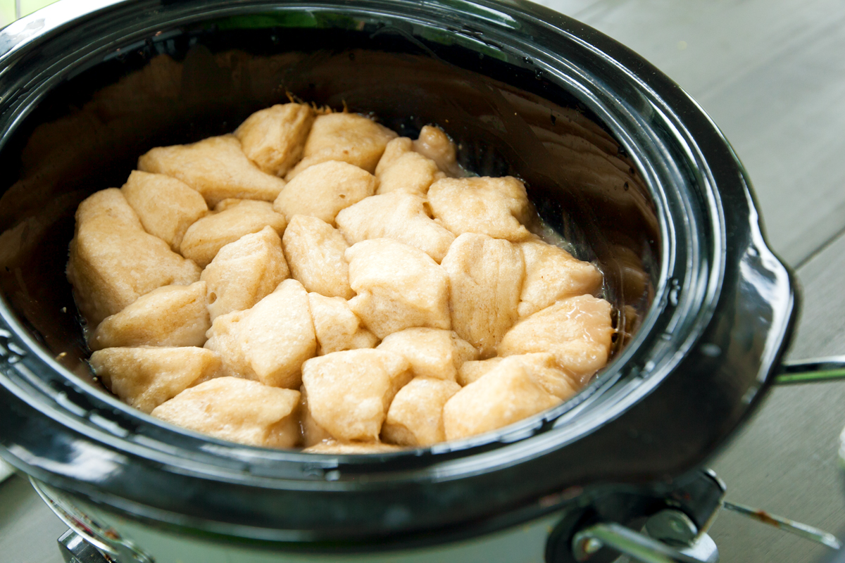 golden biscuit topping in a crock pot