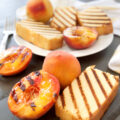 a big plate of grilled pound cake slices with grilled peaches