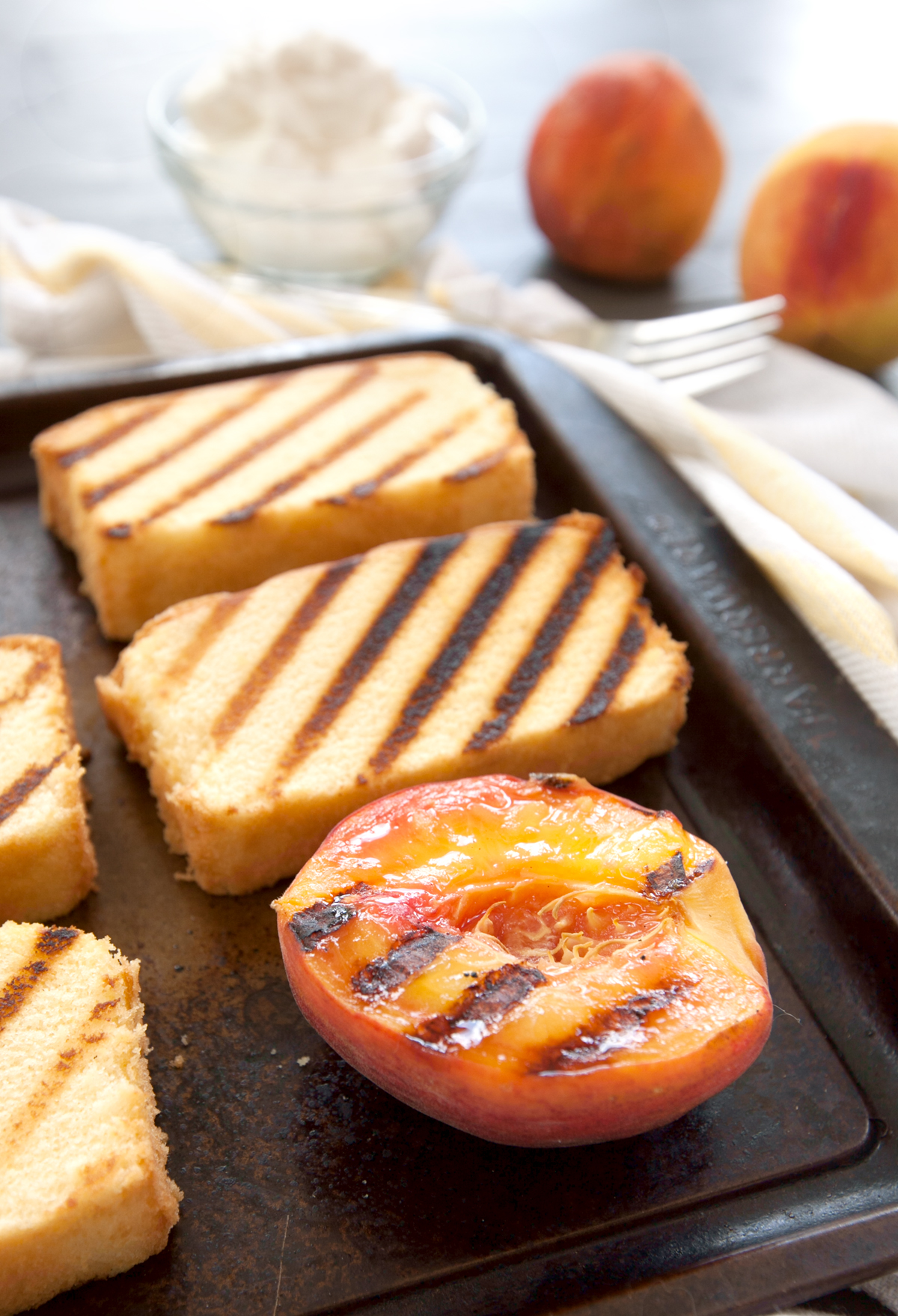close up of slices of grilled pound cake and peaches with delicious grill marks