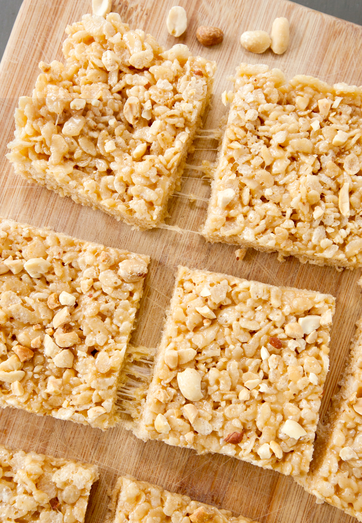 An overhead view of peanut butter rice krispie bars with stringy marshmallow