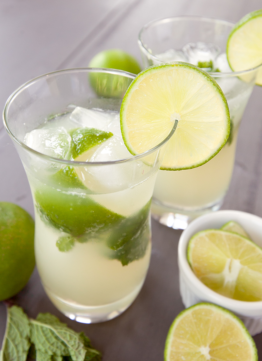 a close up of a tall virgin mojito with mint leaves and lime