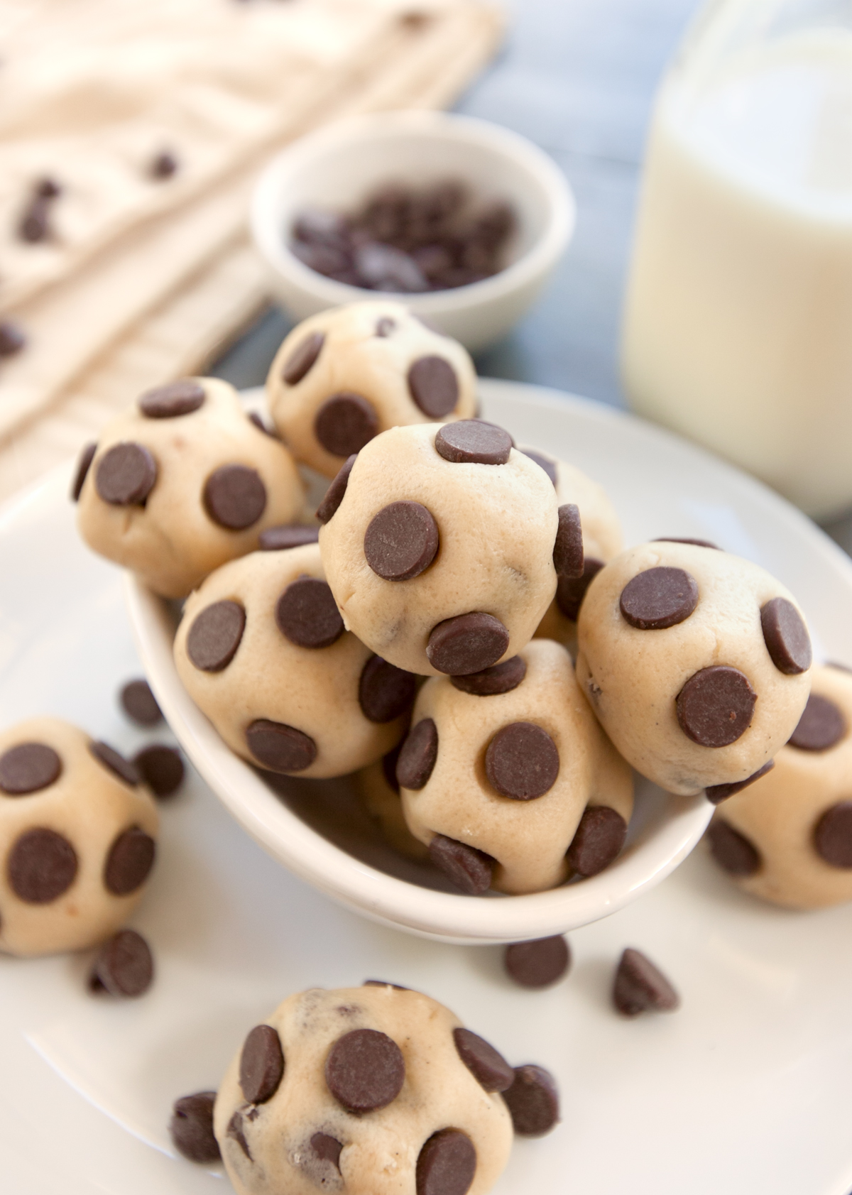 An overhead view of a bowl of cookie dough bites with chocolate chips