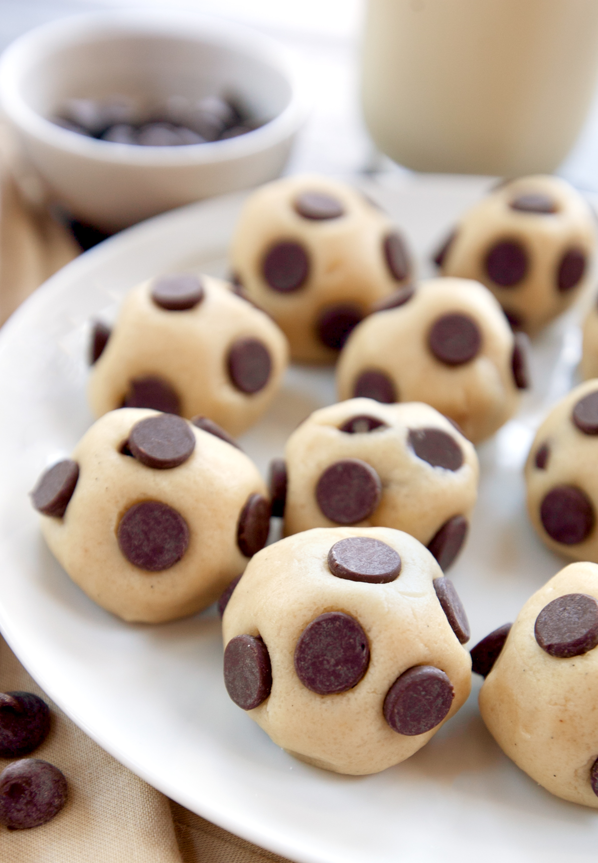 A plate of cookie dough bites stuffed with chocolate chips