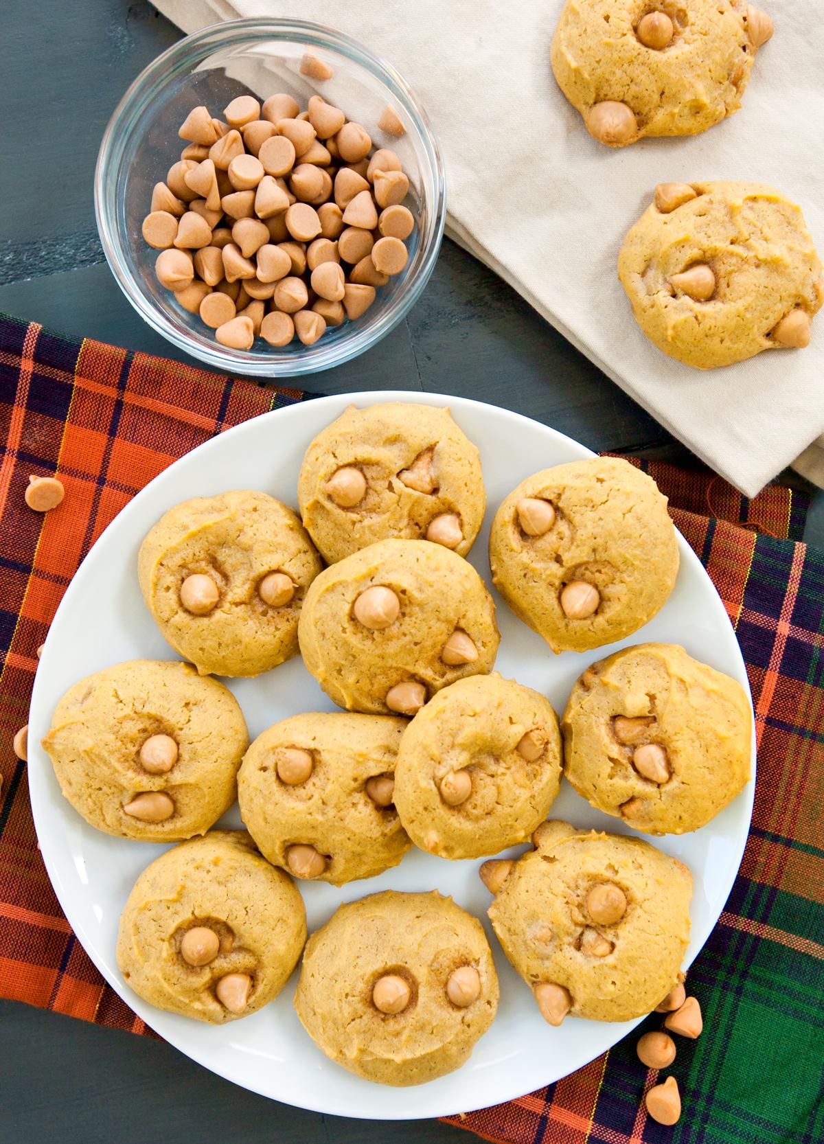 Overhead view of a plate of small pumpkin butterscotch cookies