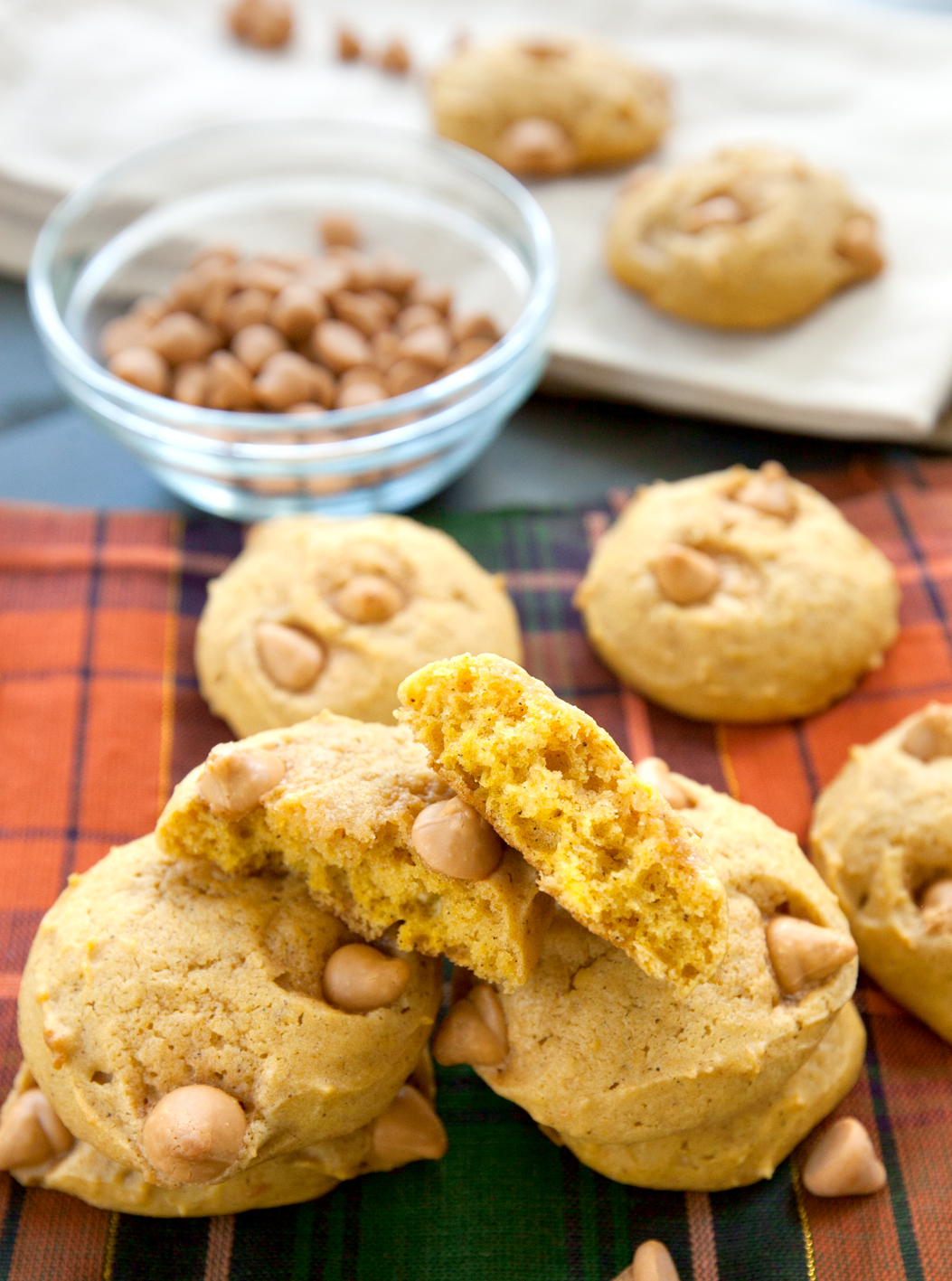 Pumpkin butterscotch cookies with one broken in half to see the soft cake-like texture inside.